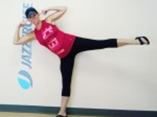Jazzercise instructor Katie Hunter Porter tests her balance and points to key components: her ears.