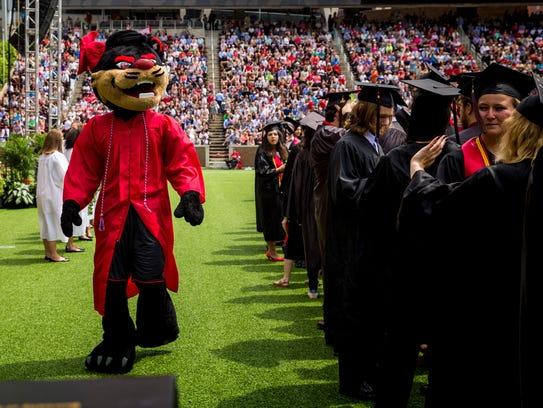 University of Cincinnati's Bearcat greets graduates