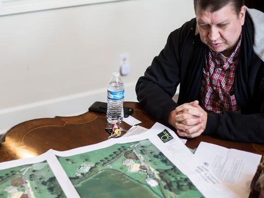 April 19, 2018 - Joe Ennis shows off some of the plans