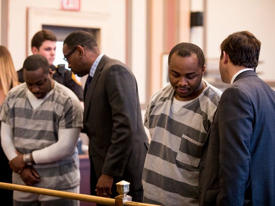 Cornell Beckley (left) listens to his attorney, Rodney