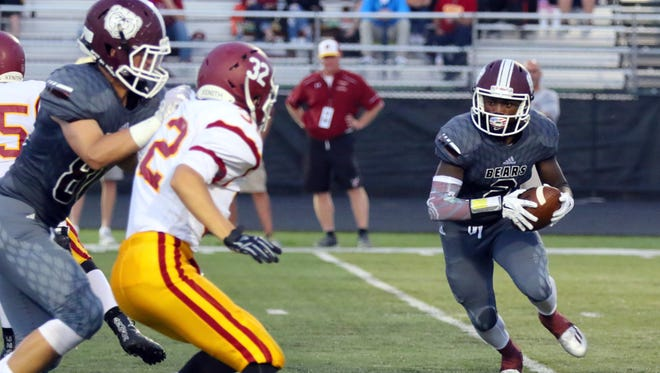 Lashon Bright (2) helped guide the Bears to a 35-0 Week 1 win over McCutcheon.