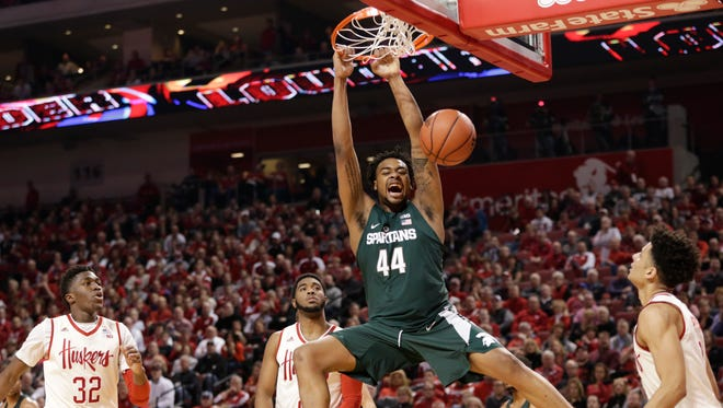 Michigan State's Nick Ward dunks over Nebraska's Jordy Tshimanga (32), Jeriah Horne, rear center, and Tai Webster, right, during the first half in Lincoln, Neb., Thursday, Feb. 2, 2017.