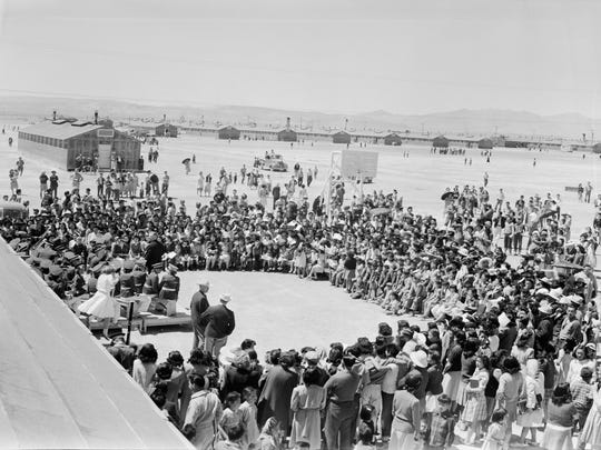 A high school band performs for a crowd at the Topaz Relocation Center in Utah on May 11, 1943. This photo is featured in an exhibit on Japanese internment at the FDR Presidential Library and Museum in Hyde Park.