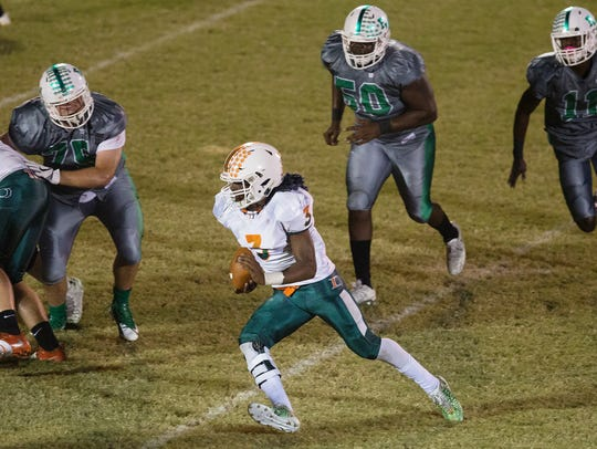 Dunbar High School's Keanu Young eludes Fort Myers