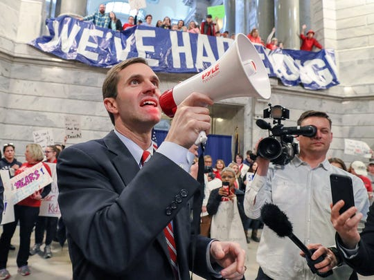 Kentucky's attorney general, Andy Beshear, speaks March 30, 2018, to a crowd of hundreds of teachers as they rallied in the state capital after pension reform was pushed through quickly the night before.