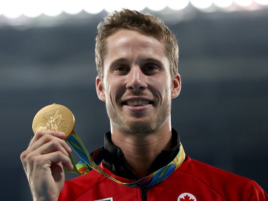 Gold medalist Derek Drouin of Canada poses during the