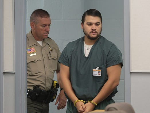 Christopher Lee who was arrested for the death of Erin Corwin enters the courthouse in Joshua Tree to enter a not guilty plea for his arraignment on Tuesday, August 26, 2014.
