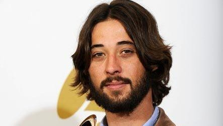"Ryan Bingham with his Grammy for ""The Weary Kind."""