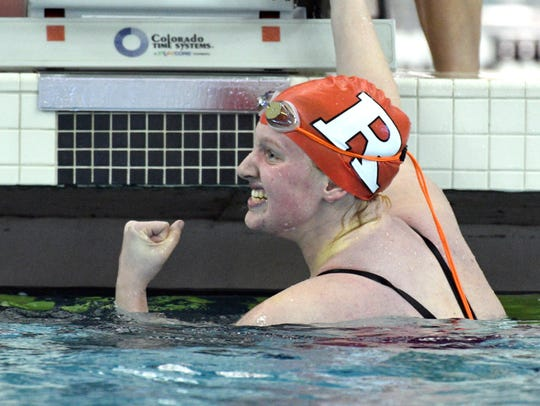 Swimming action during the North Central Conference