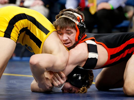 Walton/Delhi's Caleb Robinson locks up South Jefferson-Sandy Creek's Trey LaFlamme in the Division II 113-pound state final at the Times Union Center in Albany.