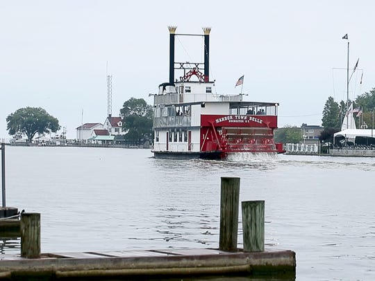 The Harbor Town Belle cruises past the Pelican's Nest