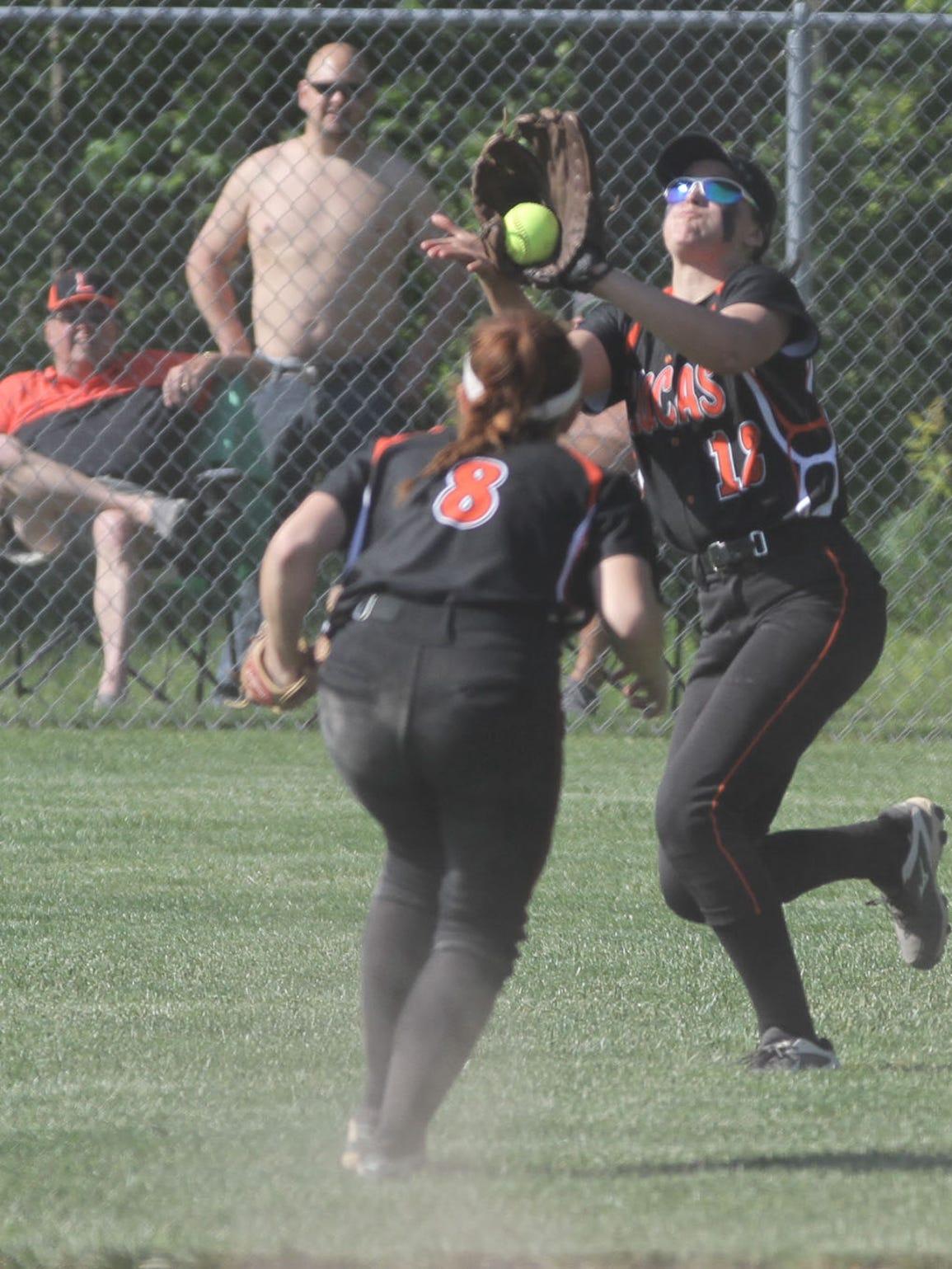Lucas' Morgan Spitler catches the ball infront of Alex