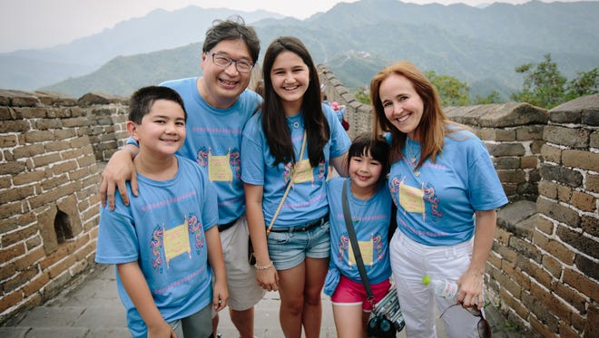 The Liu-Suskind family, during a July 2012 trip to the Great Wall of China, are, from left, Asher Liu, Dr. Don Liu, Genevieve Liu, Amelie Liu and Dr. Dana Suskind. After Dr. Liu drowned in 2012, Genevieve started a website called SLAP'D — Surviving Life After a Parent Dies.