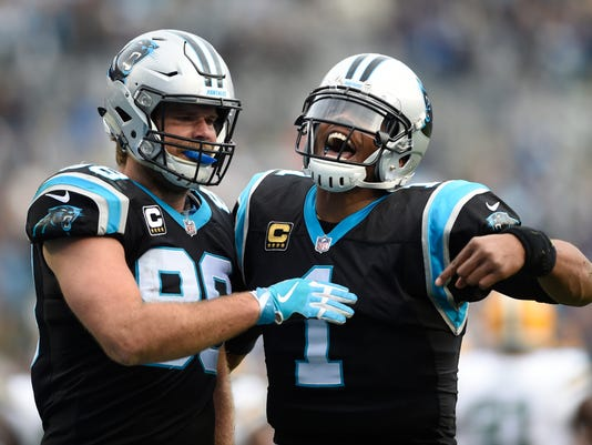 FILE - In this Dec. 17, 2017, file photo, Carolina Panthers' Greg Olsen (88) celebrates with Cam Newton (1) after a touchdown against the Green Bay Packers during the second half of an NFL football game in Charlotte, N.C.  The New Orleans Saints have to prepare for the presence of Olsen, who didn't play in either of these teams' previous two meetings this season. (AP Photo/Mike McCarn, File)