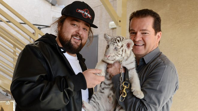 Austin Chumlee Russell of 'Pawn Stars' with Crystal (C), from the Dirk Arthur (R) Wild Magic show at the Westgate Las Vegas Resort & Casino, on Dec. 23, 2015 in Las Vegas.