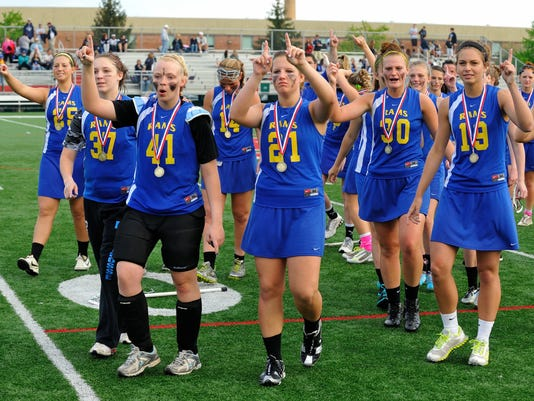 Kennard-Dale players celebrate after winning their third straight YAIAA girls lacrosse tournament championship on Thursday. (For the Daily Record/Sunday News -- Mike Zortman)