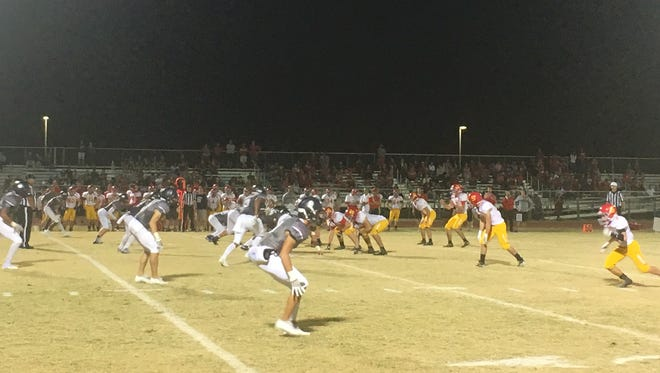Seton Catholic takes a snap vs. Higley in a 4A state playoff game.