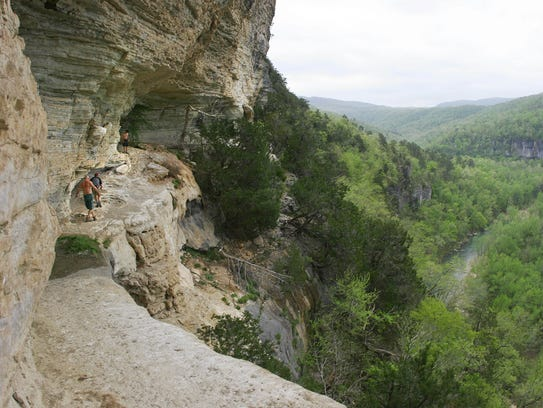 Hikers make their way back along the Goat Trail at