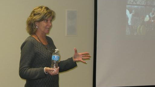 Debbie Wickham is shown talking about Community-Supported Agriculture (CSA).