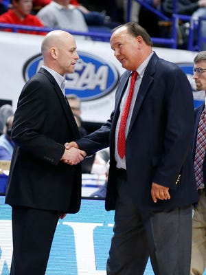 Trinity head coach Mike Szabo, left, and Scott County head coach Billy Hicks shake hands following Scott County's 54-53 win in a first round game of the Whitaker Bank/KHSAA Boys' Sweet 16 basketball tournament played at Rupp Arena in Lexington, Ky. Wednesday March 14, 2018. (Photo by Gary Landers)