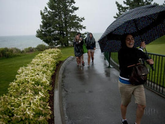 Severe weather moved through Edgewood Tahoe golf course in Stateline, Nev., causing a weather delay in the American Century Championship on Sunday, July 20, 2014.