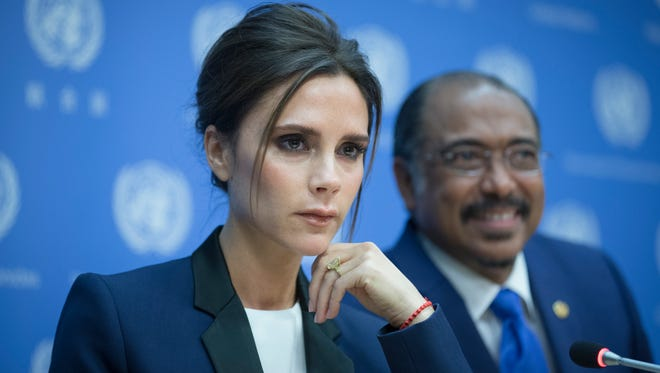 Victoria Beckham, left, takes questions from reporters alongside Michel Sidibe, Executive Director of Joint UN Program on HIV/AIDS, during a news conference announcing her as a United Nation's Goodwill Ambassador during the 69th U.N. General Assembly at U.N. headquarters, Thursday, Sept. 25, 2014.