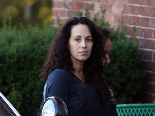 """Manuela Maria Morgado, the Mamaroneck mom accused of killing her 4-year-old son, Jason """"Jake"""" Reish arrives at Mamaroneck Village Court for a felony hearing, Oct. 17, 2012. ( Mark Vergari/The Journal News )"""
