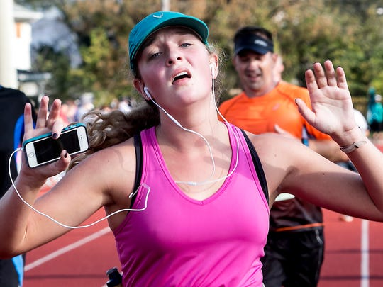Murfreesboro Half Marathon runner Madelenie Luchsinger finishes in pain as  was starting her legs were beginning the cramp at the 2015 event.