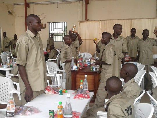 Surrendered Boko Haram Islamic militants receive breakfast