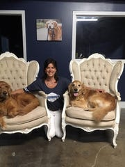 Owner/operator Alisa Hamby with her two golden retrievers,