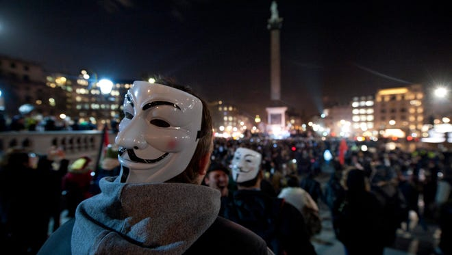 "Protesters take part in the ""Million Mask"" demonstration in London on Nov. 5, 2014."