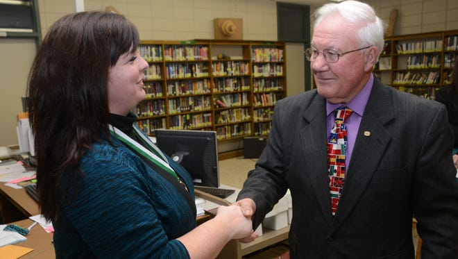 Landry Saucier (right), past state commander for Veterans of Foreign Wars Post 1736, shakes hands with Faith Normand, an English teacher at Rapides High School on Tuesday. Normand received the Smart/Maher VFW National Citizenship Education Teacher Award at the district level and will advance to state.