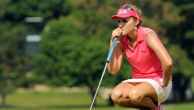 Lexi Thompson studies a putt Saturday during the third round of the Meijer LPGA Classic golf tournament in Belmont, Mich.