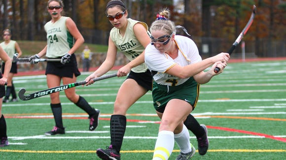 Lakeland's Dana Bozek (4) takes a backhand shot on goal during their 4-0 win over Vestal in the class B regional final field hockey game at Valhalla High School on Saturday, Nov. 7, 2015.