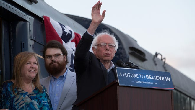 """May 14, 2016 -- Bowling Green, Ky. --Democratic Presidential Candidate Bernie Sanders visited residents of Bowling Green, Ky. on Saturday, May 14, 2016 during his """"A Future to Believe In Bowling Green Rally."""" The event took place at The Historic Railpark and Train Museum. Bernie Sanders waves to the crowd after appearing from inside the rail car."""