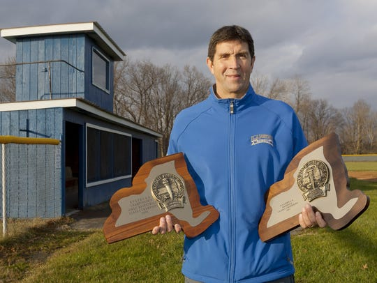 Stuart Dean with the state championship trophies he
