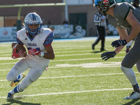 Las Cruces High's Ivan Molina looks to beat a Rio Rancho defender during Saturday's Class 6A state championship game at Rio Rancho High School.