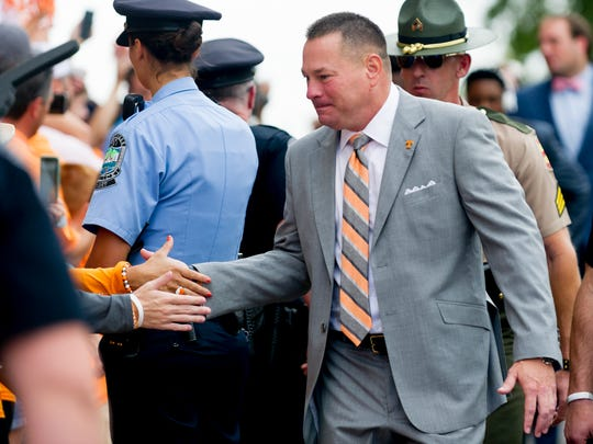 Tennessee Head Coach Butch Jones greets fans during the Tennessee Volunteers vs South Carolina Gamecocks game at Neyland Stadium in Knoxville, Tennessee on Saturday, October 14, 2017.