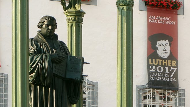 A statue of Martin Luther stands tall in his hometown of Wittenberg, which, along with the rest of Germany, will celebrate the 500th anniversary of the Reformation.