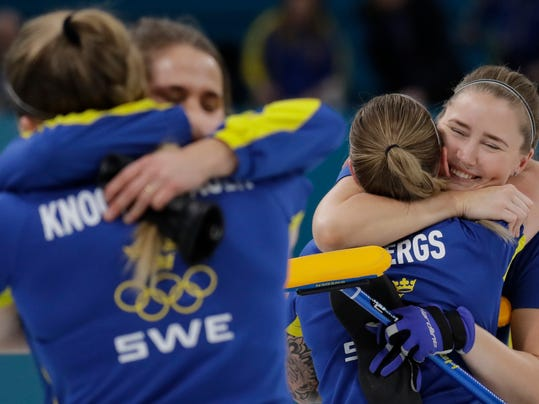 Sweden's women's curling team embrace after winning against Britain during the women's curling semi-final match at the 2018 Winter Olympics in Gangneung, South Korea, Friday, Feb. 23, 2018. (AP Photo/Aaron Favila)