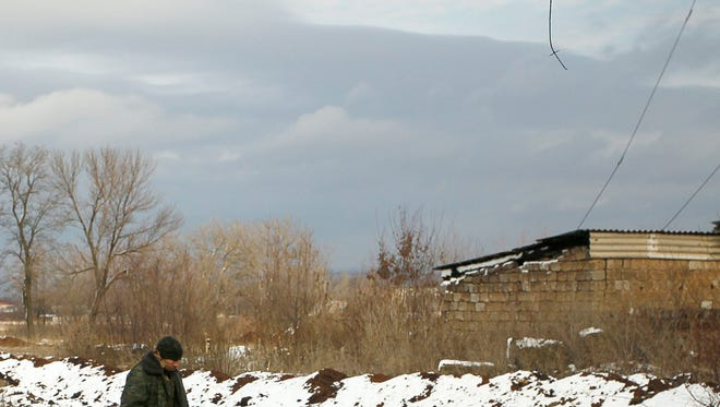 A pro-Russian rebel patrols an area at the front line with Ukrainian government troops in Zaicevo in eastern Ukraine on Dec. 5, 2015.