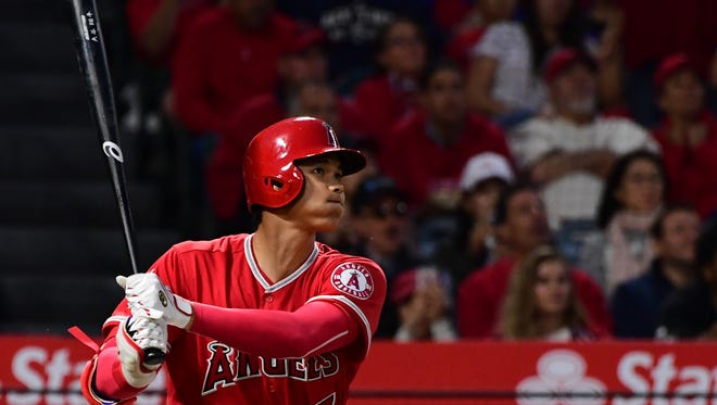 The Angels' Shohei Ohtani follows through on his solo homer against the Yankees at Angel Stadium in Anaheim, Calif.