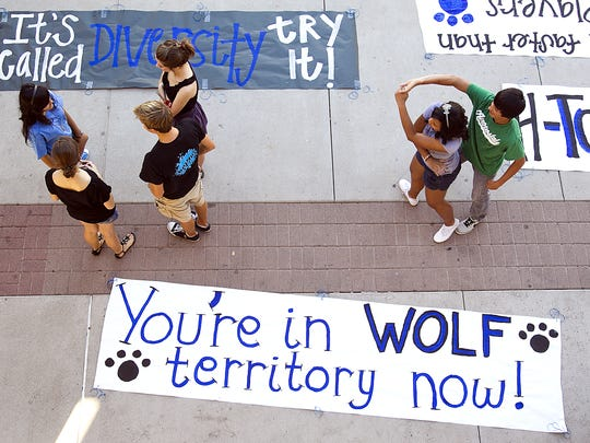 Chandler High School students dance after painting banners for an upcoming football game.