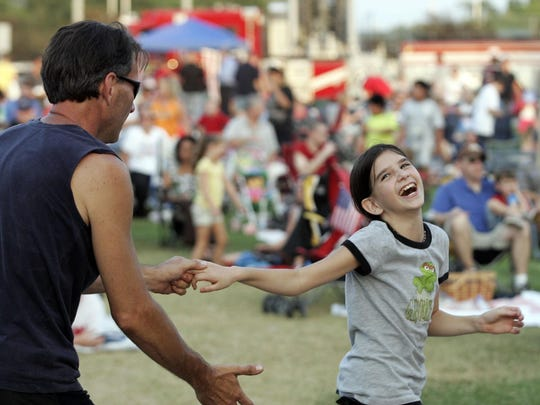 Victorya Day dances with her dad Ray Day at the Smyrna Fourth of July Celebration at Lee Victory Park. This year's event is set for July 3.