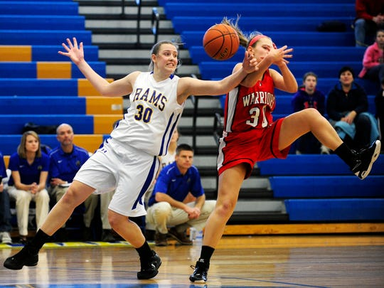 Kennard-Dale senior Sara Tarbert, left, had a week to remember. She led the Rams to three wins and, Friday night, became the school's girls' basketball all-time leading scorer. (Daily Record/Sunday News -- Chris Dunn)