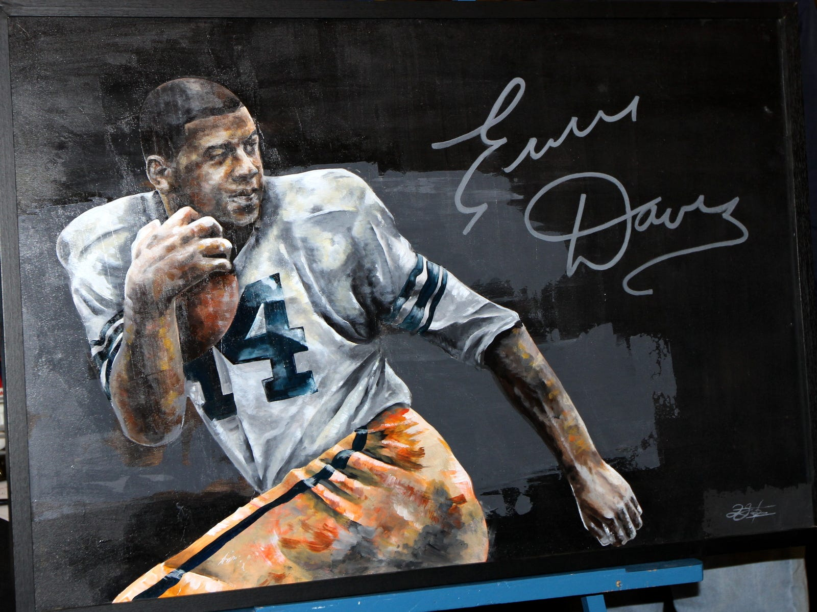 This portrait of Ernie Davis, which was commissioned by artist Rashad Sandroni, was unveiled Saturday by the Chemung County Hall of Fame committee at the Arnot Mall in Big Flats.