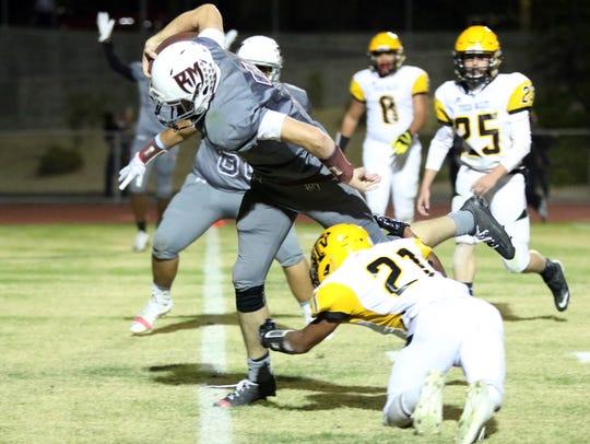 Rancho Mirage's quarterback David Talley gets into