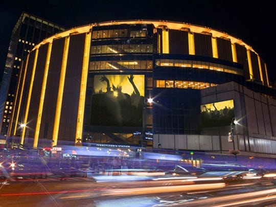 A view of Madison Square Garden at night from the outside
