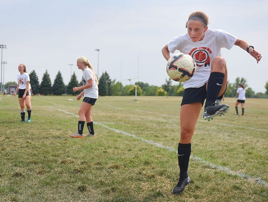 Megan Etrheim tries to pass the ball back and forth