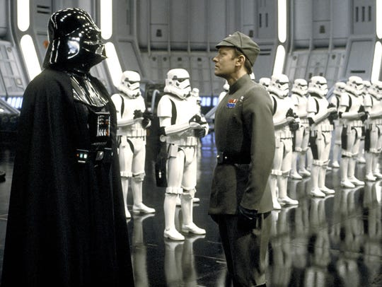 Darth Vader (left, voiced by James Earl Jones) leads